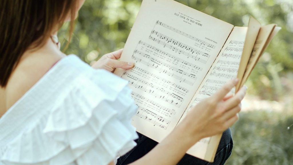 Woman holding a music sheet