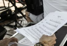Man holding a music sheet with Opus