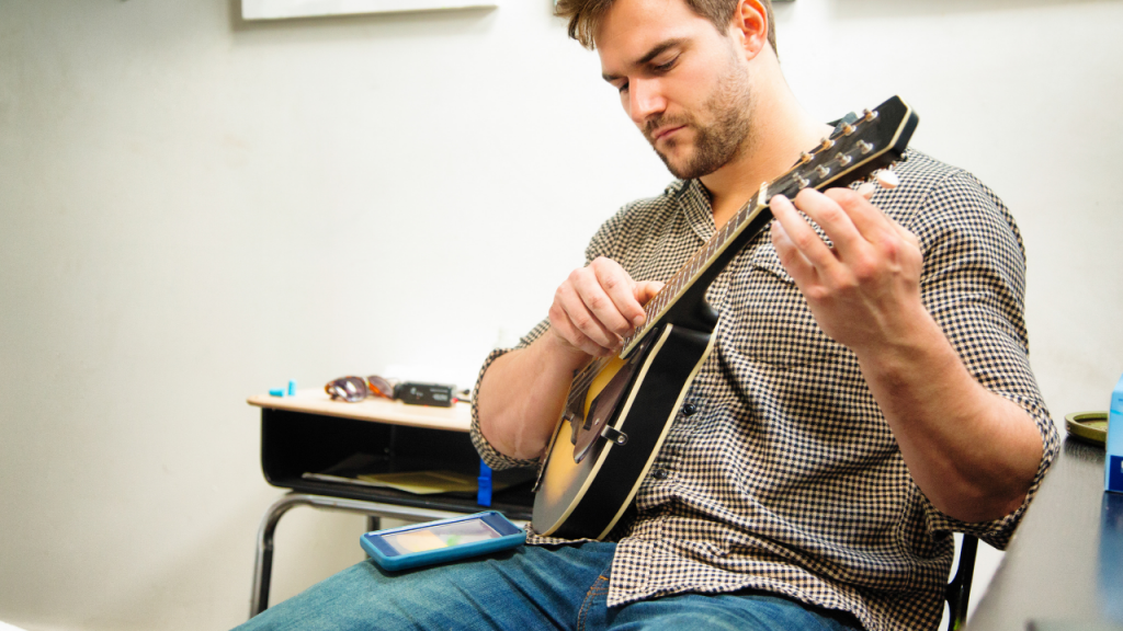 A person mandoling tuning