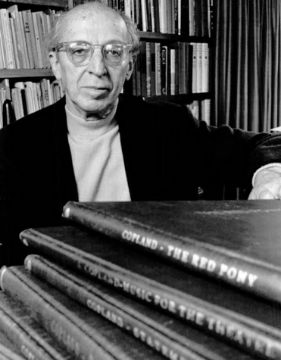 A black and white photo of Aaron Copland